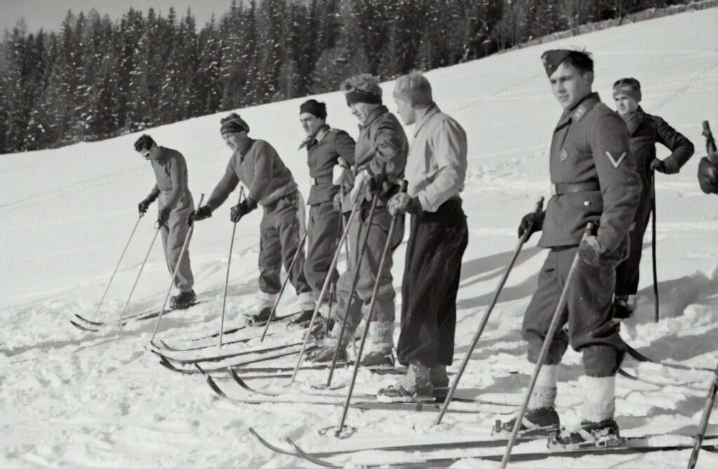 men on old skis
