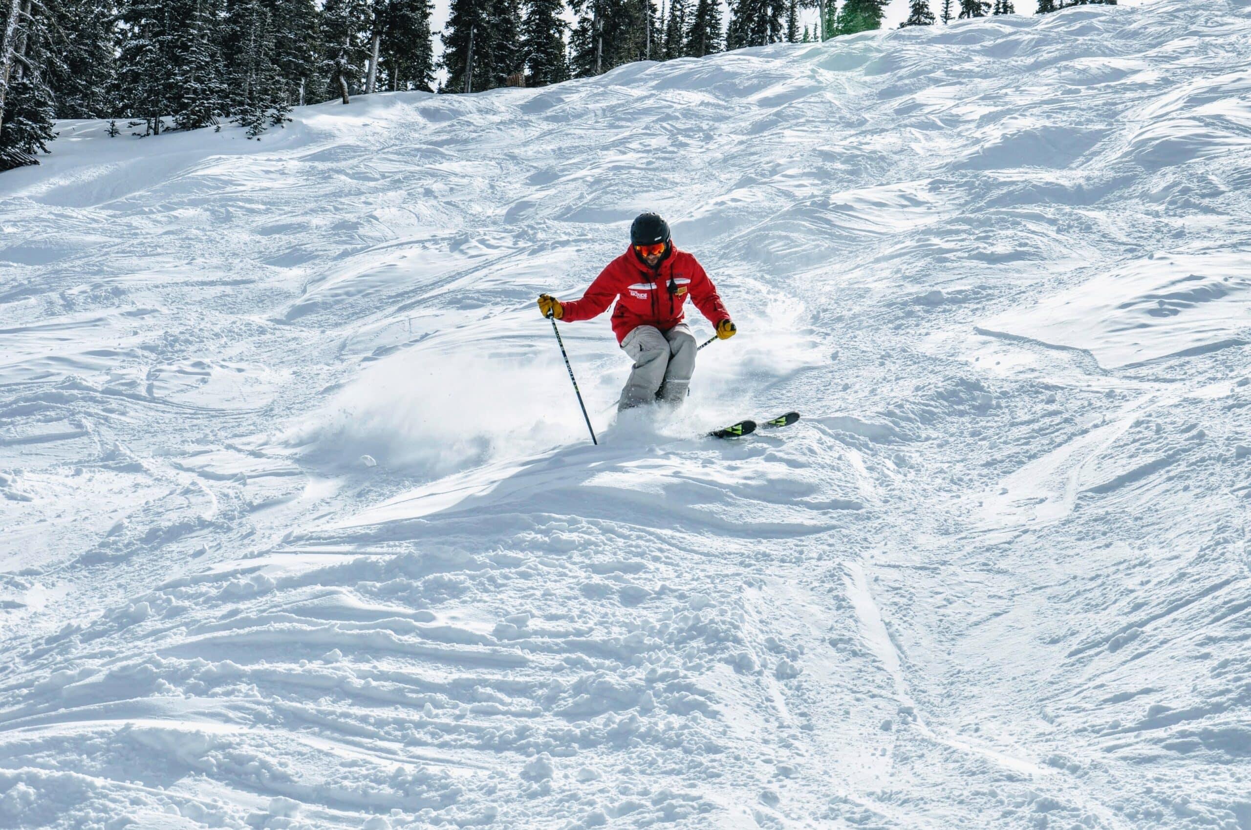 man skiing moguls with best mogul skis
