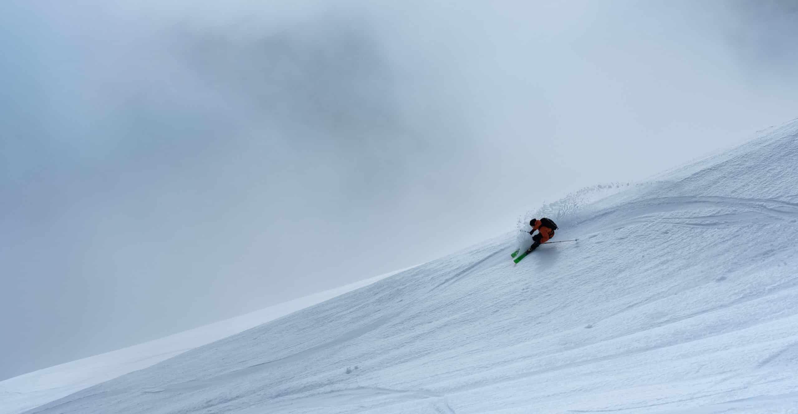 man skiing hard hill