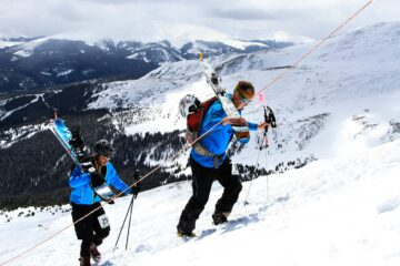 skiers in backcountry with best ski walkie talkie