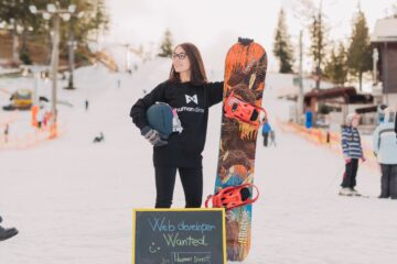 snowboarder with board in offseason
