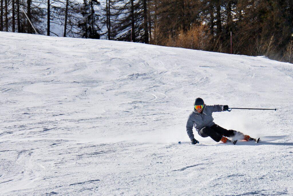 man skiing fast