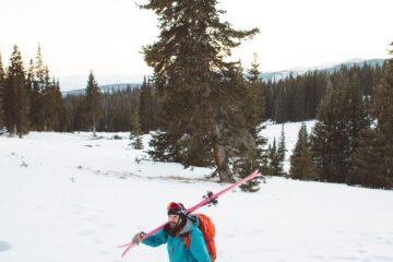 man using ski carry straps