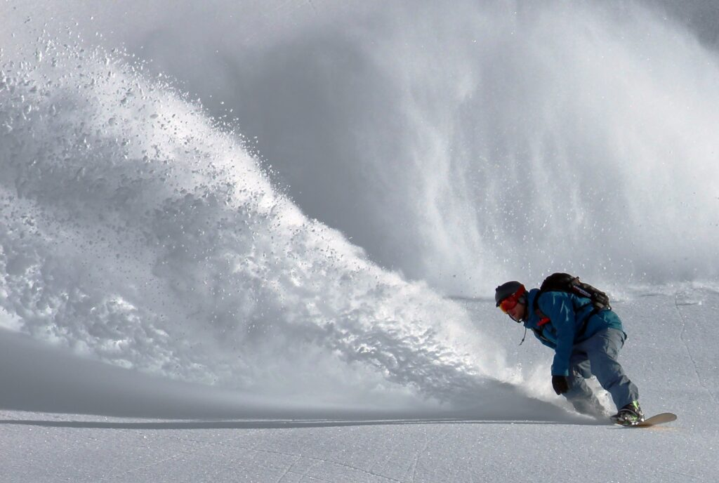 snowboarder in powder
