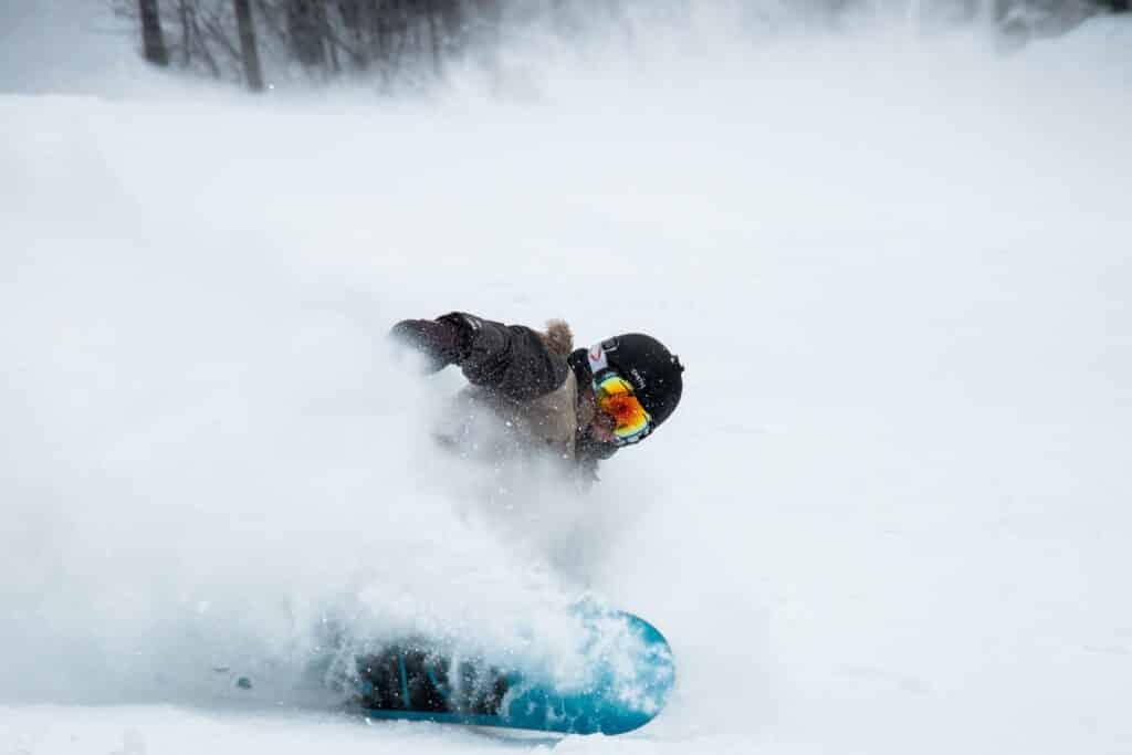 beginner snowboarder doing trick