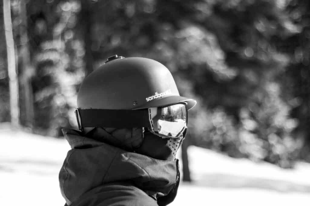 man in ski helmet with bluetooth and headphones
