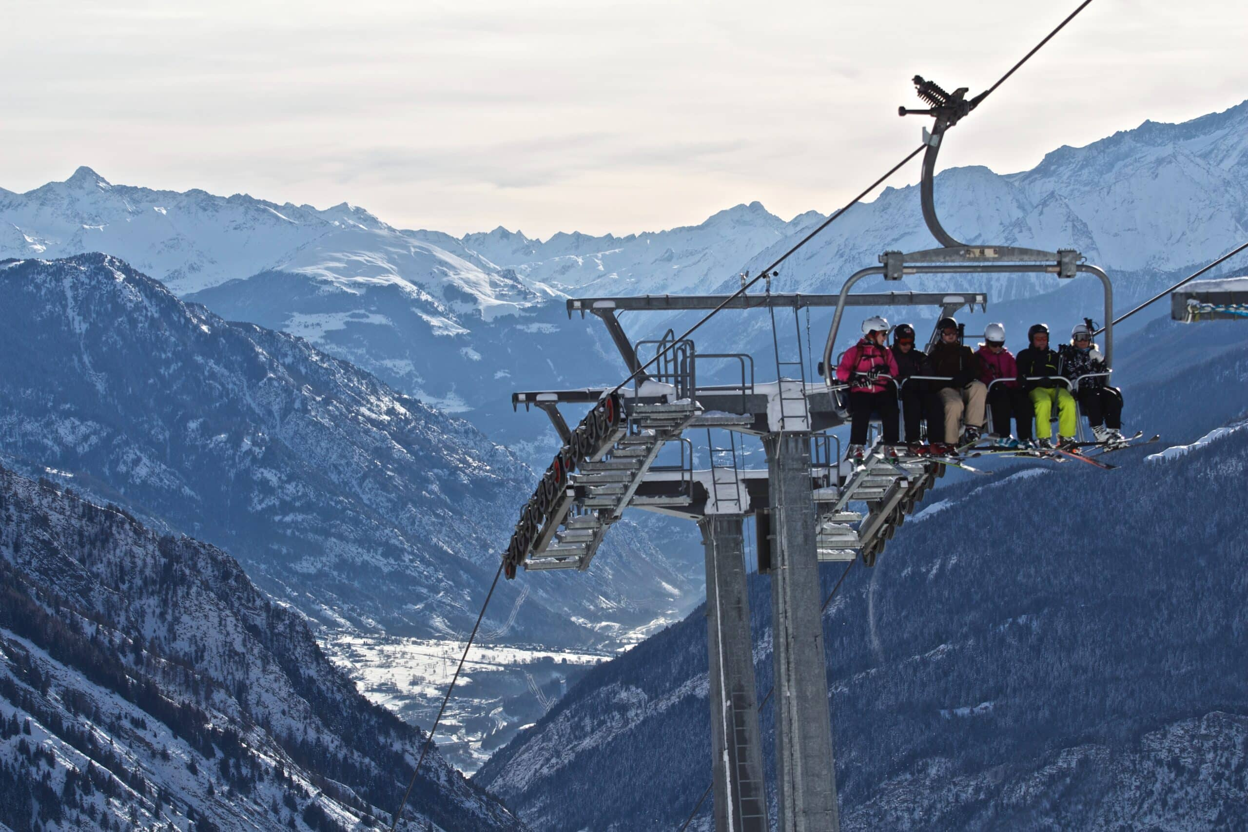 skiiers and snowboarders on a lift