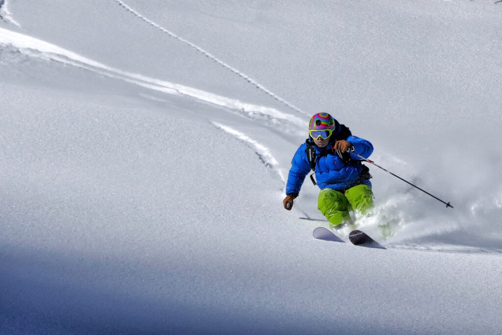 Man skiing powder with long skis