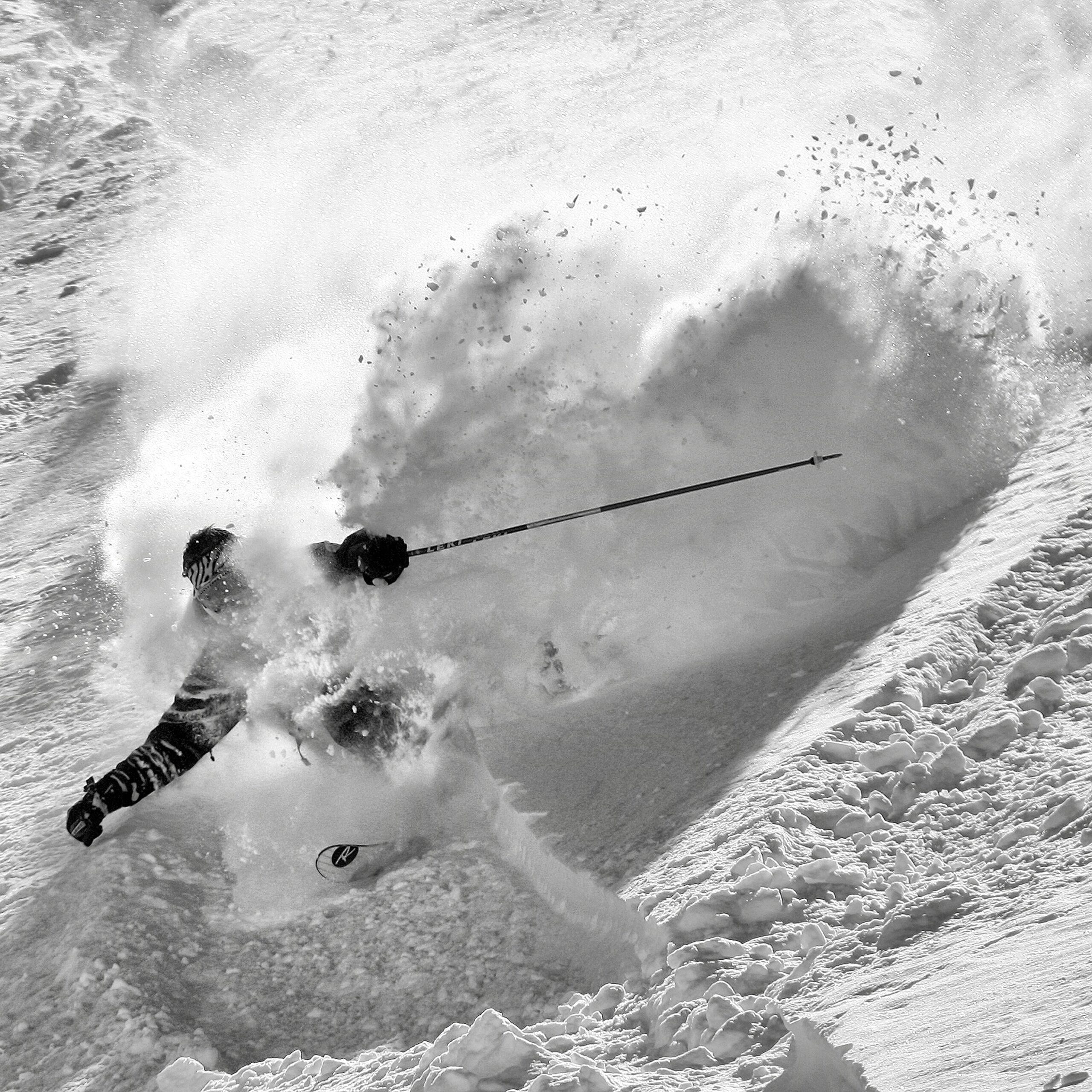 person skiing in powder