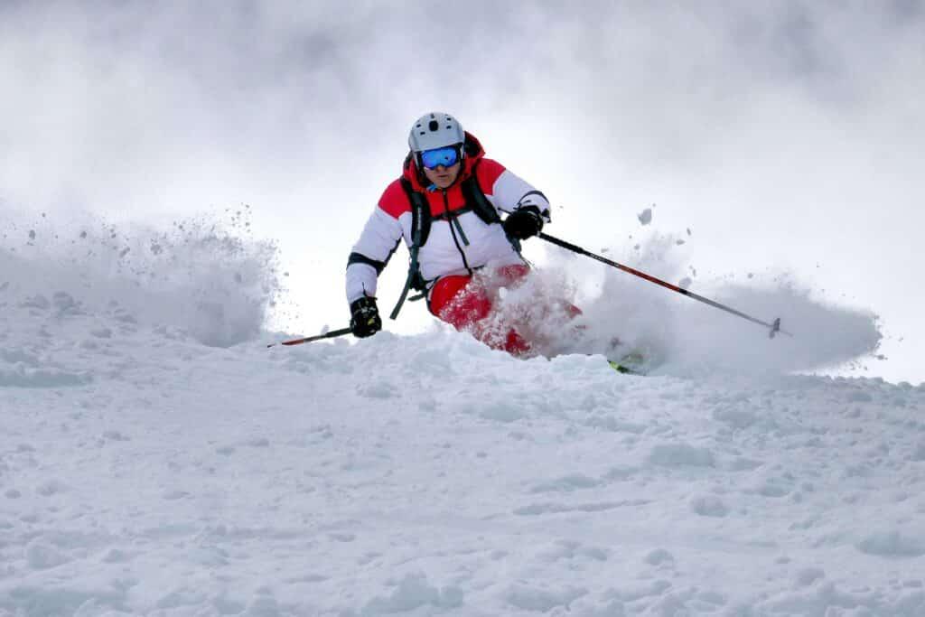 man skiing moguls