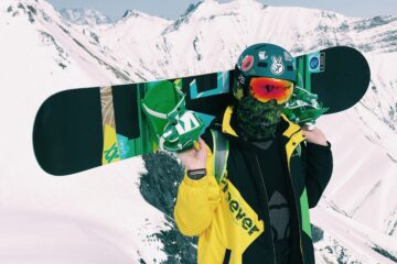 man teaching himself to snowboard