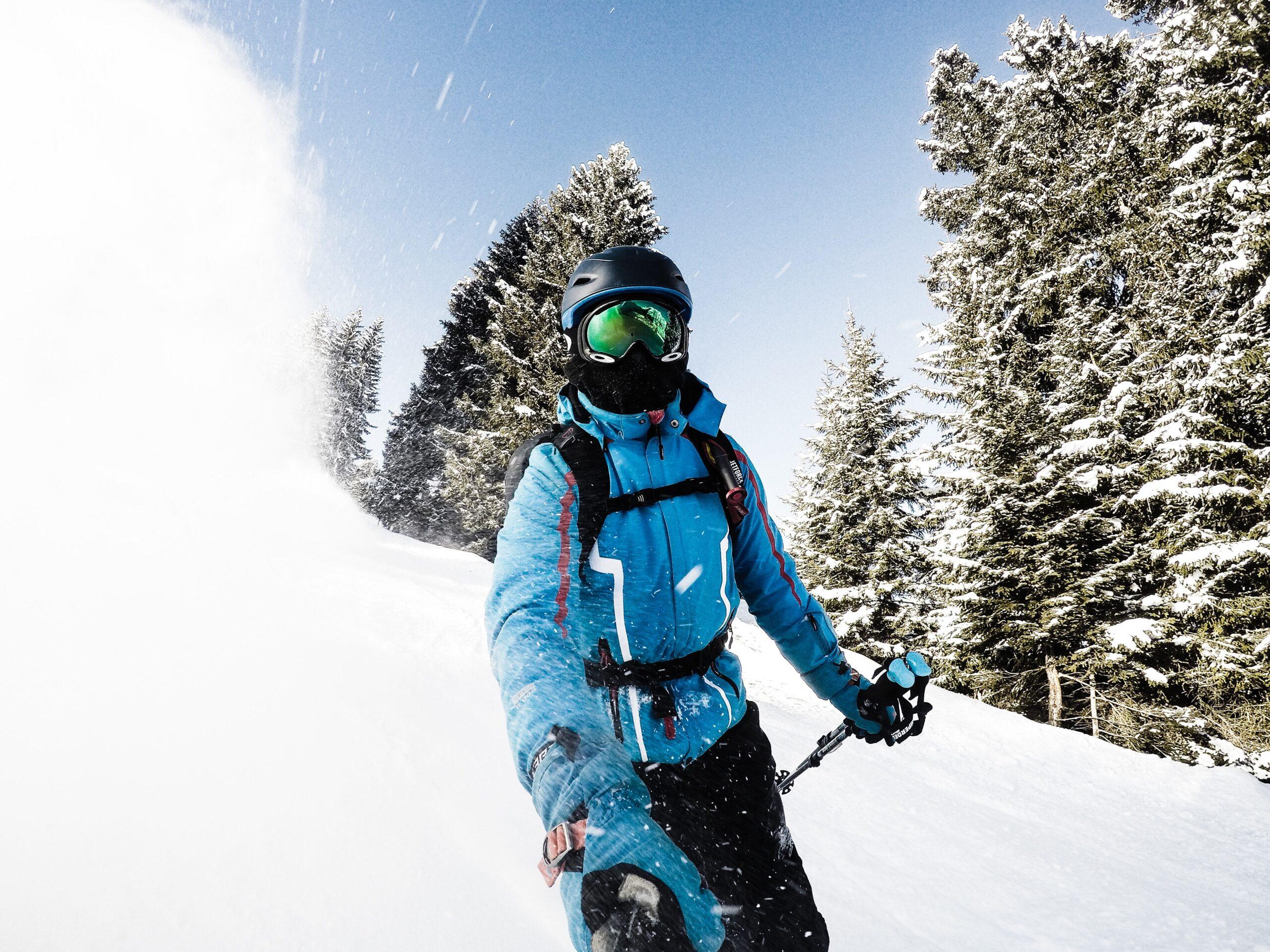 man in ski helmet with in helmet headphones
