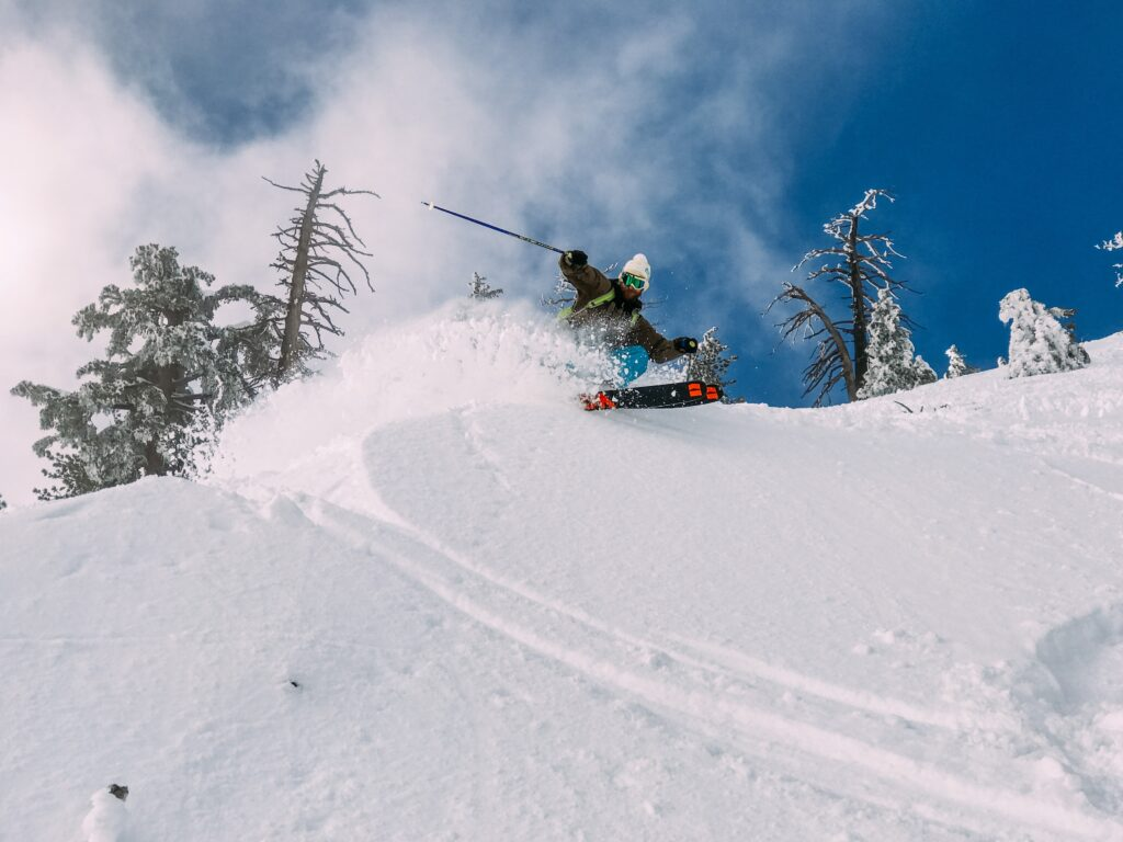 skiier turning in powder