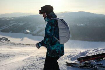 man in ski gloves