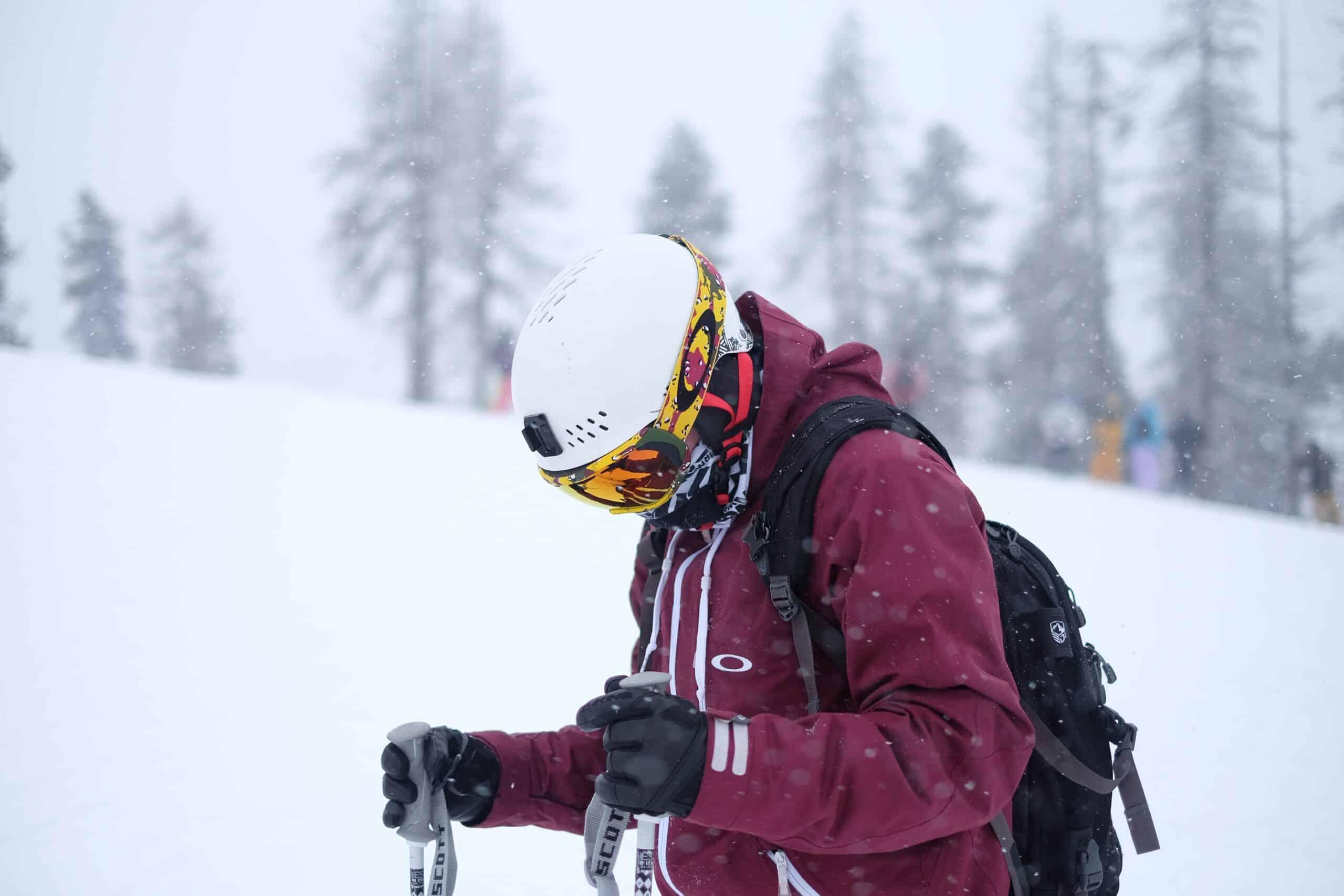 Man in ski goggles in low light