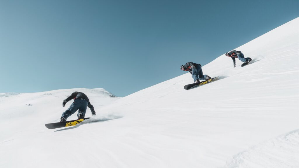 Snowboarders with snowboard bindings