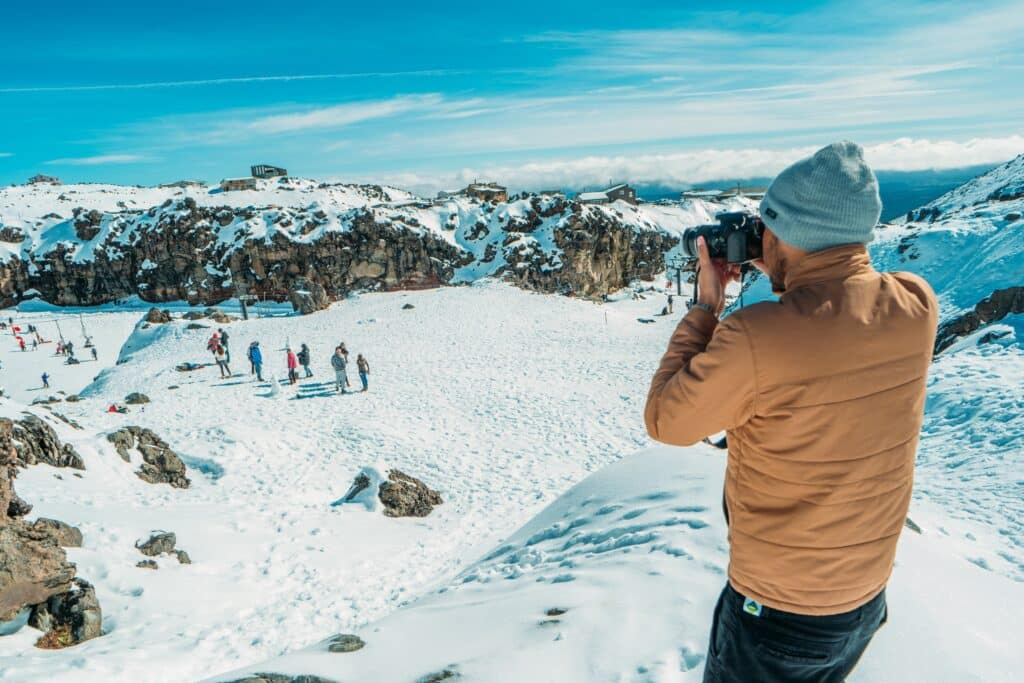 how to keep dslr warm while skiing
